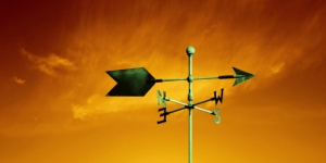 copper weather vane with colorful sunset sky, panoramic frame